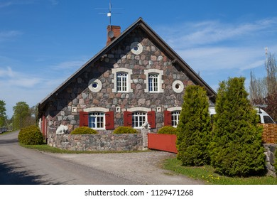 Front view of traditional granite house in Estonia