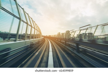 Front view of train moving in city rail with moderate train motion blur. Train Transportation concept.