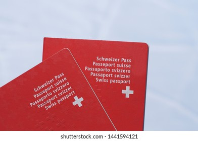 Front view of two Swiss passport with white background