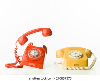 front view of two vintage phones ringing, isolated on white background
