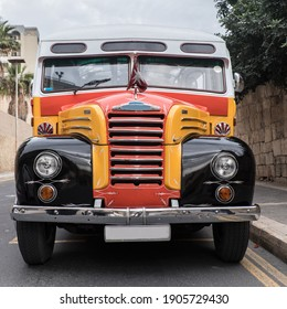 Front view of typical old Malta bus.