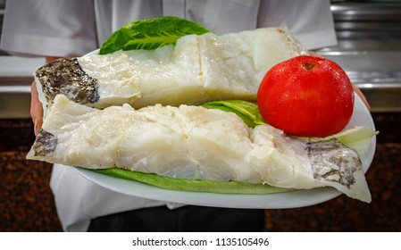 Front view of waiter showing raw cod plate