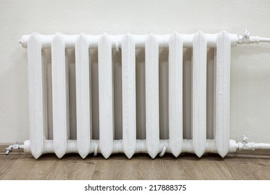Front view white iron radiator central heating in room