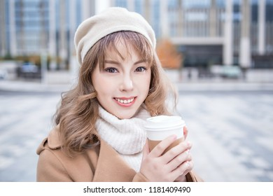 Front view of a woman drinking coffee