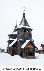 Front view of a wooden church in snow