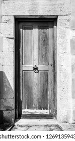 Front view of wooden door with door knocker Crete Greece Europe