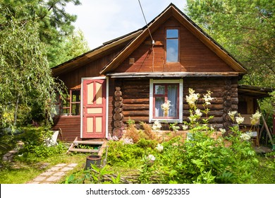 front view of wooden house in russian village in sunny summer day