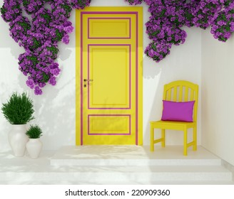 Front view of yellow door on a white house with window. Beautiful purple roses and chair on the porch. Entrance of a house.