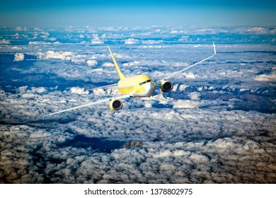 Front view of yellow passenger plane in flight. Left heeling of aircraft. Cumulus clouds in the aircraft background.