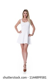 Front view of young beautiful blonde woman in white dress isolated on white background.