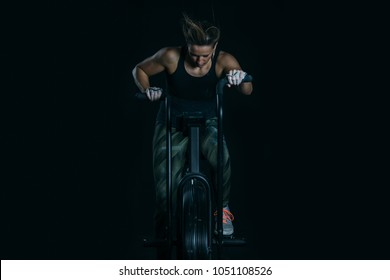 Front view of a young sporty woman doing calorie assault exercise on a fitness routine at the box gym