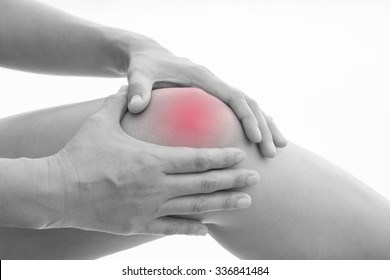 Front view of a young women knee muscle pain. Red around the pain area.