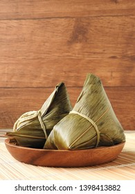 Front view of zongzi also called  rice dumplings or sticky rice dumplings on wooden plate. Dragon boat festival is a traditional festival of East Asian culture. Food concept. Copy space.