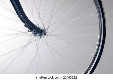 front wheel of road bike with blue forks
