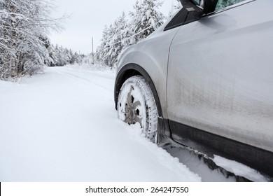 Front wheel in winter tire in snowdrift