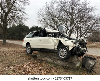 front of white car get damage by accident on the road. car accident