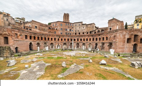 Front wide angle view of the Trajan's Market ruins in Rome city centre, Italy, with dramatic cloudy sky in the background.