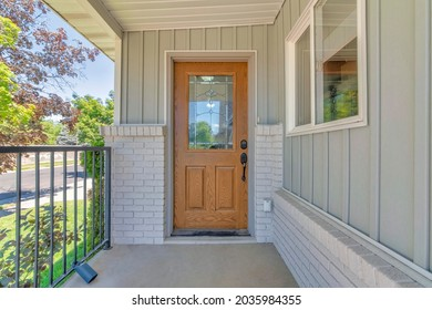 Front wooden door exterior with ornate glass panel and digital entry access with keypad