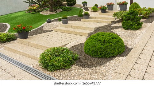 Front yard with modern outside stairs made of concrete paving - Shutterstock ID 1655743777