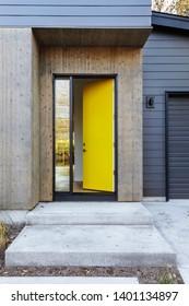 front yellow door that is open