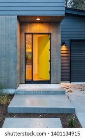 Front yellow door that is opened and illuminated