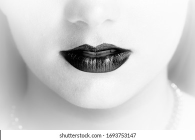 Frontal Close up of beautiful black and white lips of sexy girl with light background