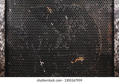 frontal close up image of speakers grill. Musical instruments and sound equipment background.