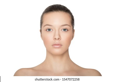 Frontal portrait of young woman brunette, skin care, free make-up, isolated on white background. Caucasian model.