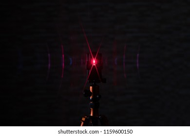 A frontal shining cross line laser in the dark