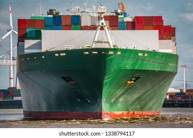Frontal shot of a green container ship