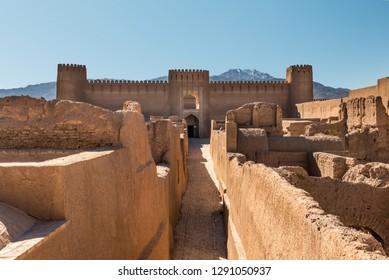 Frontal view of an adobe castle Rayen close to the town Kerman under mountain Haraz, Iran