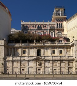 Frontal view of Kings fountain monument (Chafariz Del Rei) in Alfama disctrict, first built in the XIII century, below the palace of the same name, built in the late XIX century. Lisbon, Portugal.