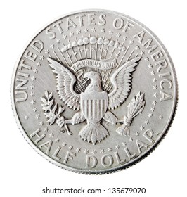 Frontal view of the obverse (heads) side of a silver half Dollar minted in 1964.Depicted is the US presidential seal. Isolated on white background.