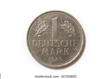 Frontal view of the obverse (heads) side of a a 1 Deutsche Mark (DM) coin minted in 1989. Depicted is the denomination of the coin between Oak leaves. Isolated on white background.