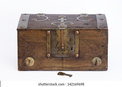 Frontal view of an old wooden chest on white background. Wooden Chest.