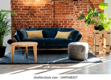 Frontal view of sofa in modern minimalist interior of living room. Brick wall background