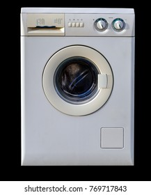 Frontal view of a used washing machine with closed door, isolated on a black background