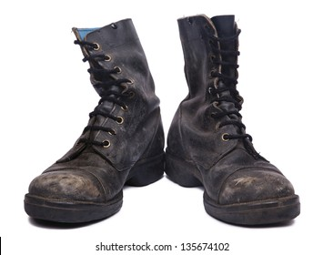 Frontal view of a very worn pair of boots, issued by the Israeli army (IDF). isolated on white background.
