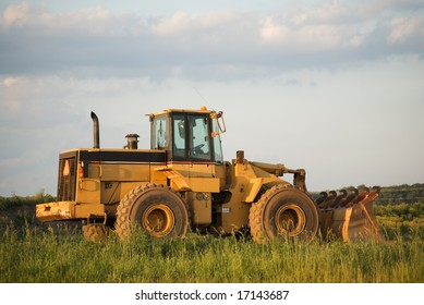 Front-end loader on a work site in rural America