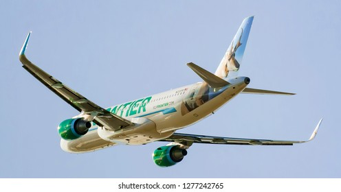 Frontier beautiful passenger planes taking off at the International Cincinnati Northern Kentucky airport with animal design on tail Florence Kentucky USA January 5th 2019 Florence Kentucky