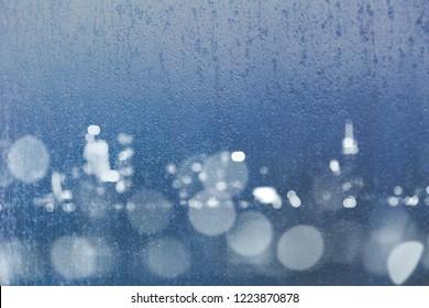 frost window bokeh skyline composite with city lights and skyline, cold blue tones