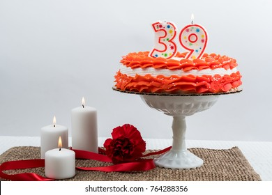 Frosted cake with 39 candl