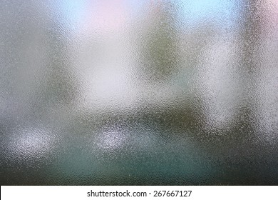 Frosted glass texture. Colorful lights background.