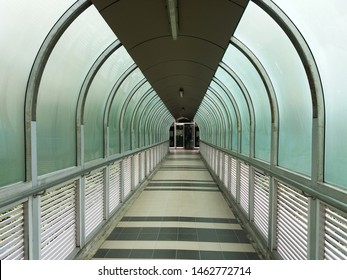Frosted glass wall and  aluminium louver panel on the Skywalk between buildings.   Lighting and Ventilation concept.