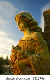 Frosty cemetery angel in early morning light