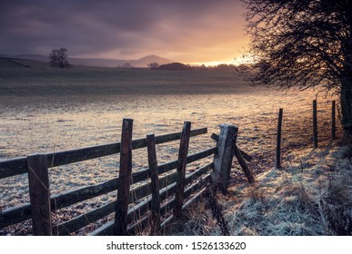 A frosty english countryside sunrise in winter