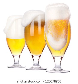 Frosty glass of light beer isolated on a white background