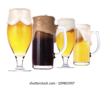 Frosty glass of light and dark beer isolated on a white background.