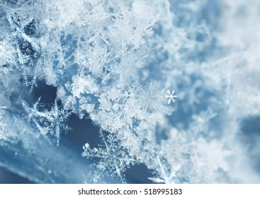 Frosty ice crystals on newly fallen snow background
