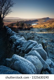 A frosty morning view of a public footpath along Hadrians wall in winter